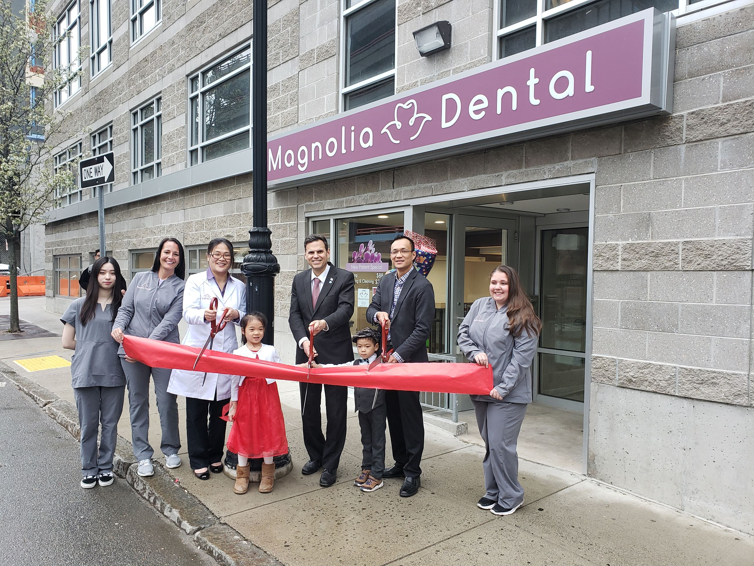 Magnolia Dental employees with (from left holding scissors Owner Dr. Yee Yan Chen, daughter Allison,