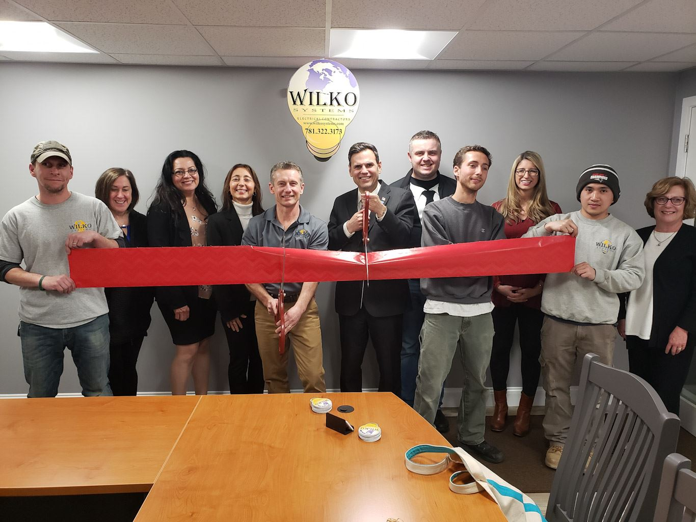 Wilko employees and Chamber of Commerce members with (center, holding scissors) Owner Bill Kotowski