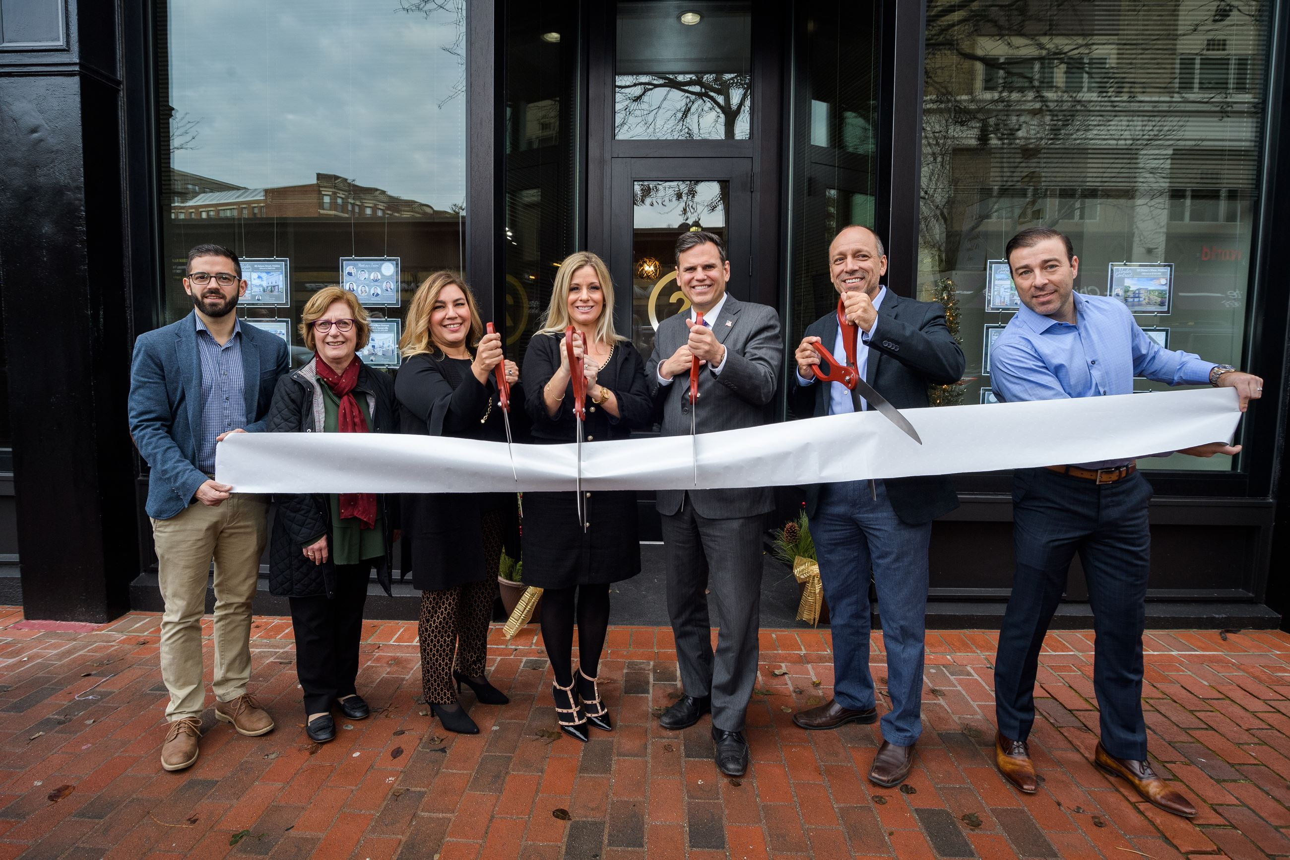 Kristin Gennetti Group Ribbon Cutting