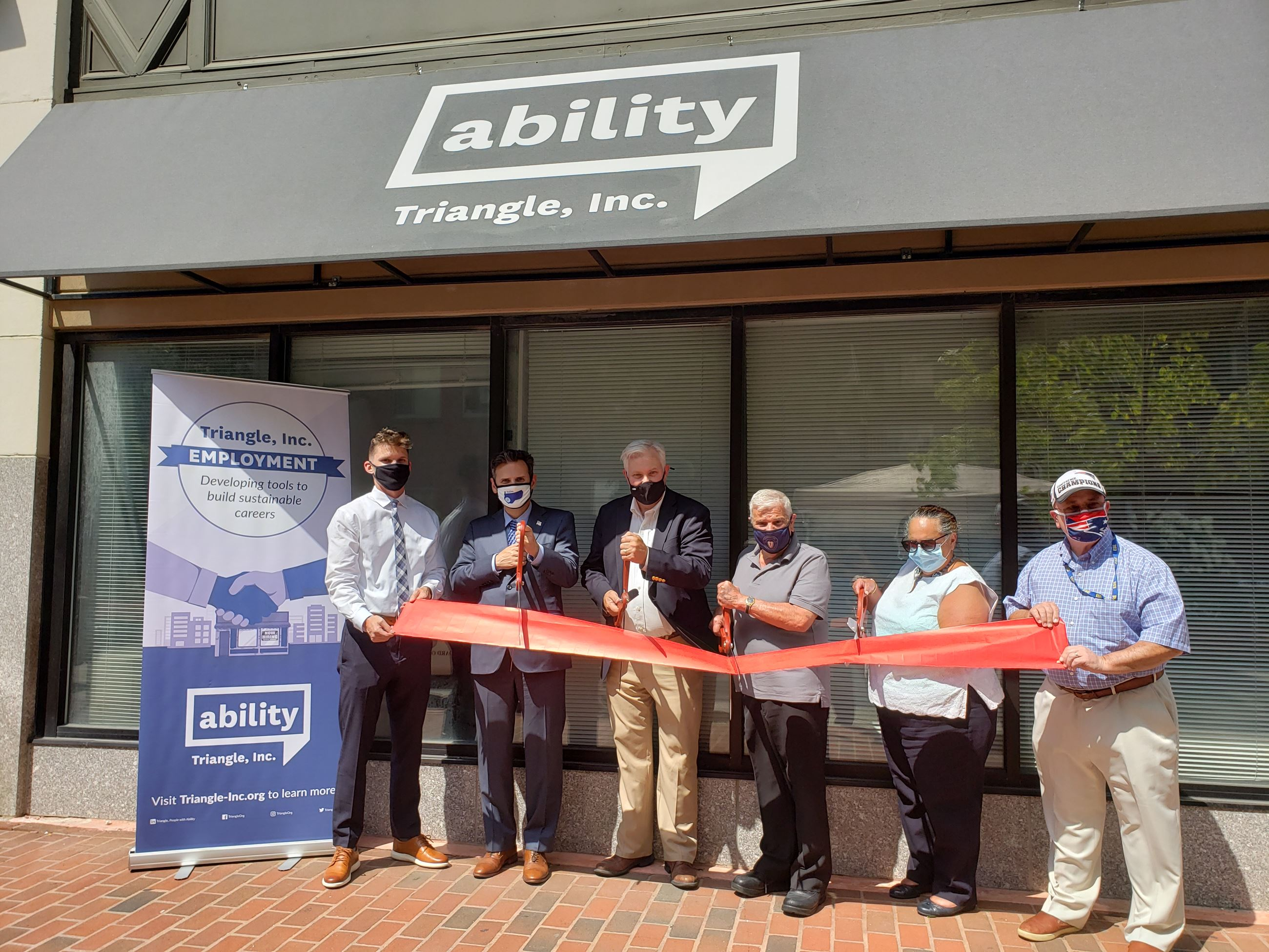 Triangle Ribbon Cutting Photo